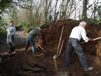 Workforce repairing bank near Velwell Orchard