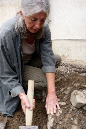 Jenny demonstrating cobble stoning